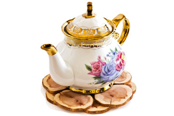 Ceramic teapot on Wooden stand .