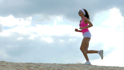 girl is engaged in sports jogging