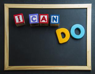 Wooden word I can do on blackboard