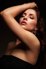 Beautiful sexy female model posing in fashion earrings