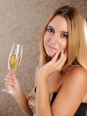 Pretty young woman with glass of champagne.