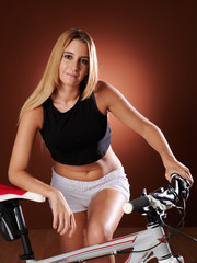 Pretty young woman with bike.