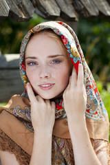 Beauty woman in the national patterned scarf