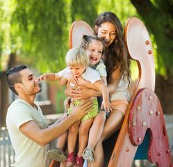 Parents helping kids on slide