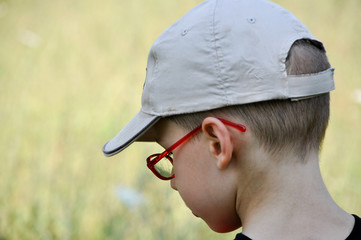 Red glasses and hat young boy