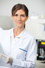 Confident Female Scientist In Lab