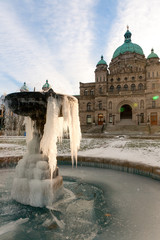 Victoria Parliament Building and forzen fountain in winter, Vict