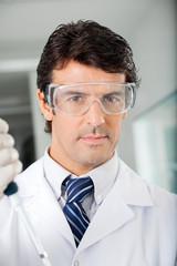 Confident Scientist In Protective Eyewear