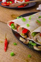 Chicken tortilla with mushrooms, garlic