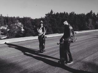 two longboarders on the spot