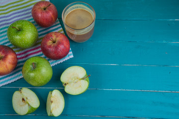 Farm fresh organic red and green apples pressed juice in glass
