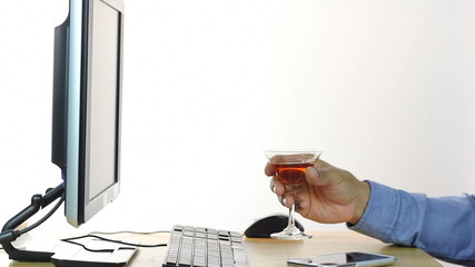 Businessman drinking wine at work place