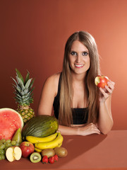 Young woman eating fruit.