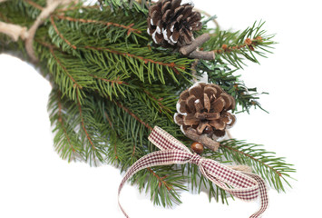 tied bundle of Christmas tree with pinecone