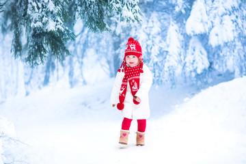 Little girl running in a snowy park