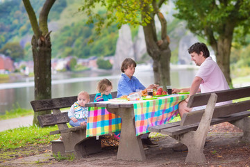 Young father and kids at picnic