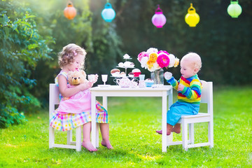 Little children at doll tea party