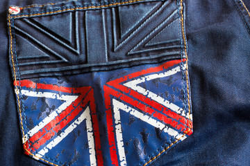 Dark blue jeans with a picture of the British flag on the pocket
