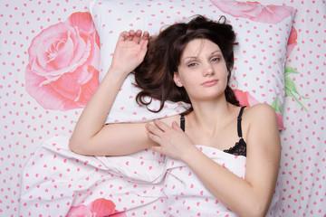 Beautiful girl has woken up in bed