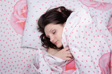 Girl covered with a blanket in bed