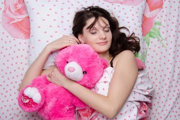 Girl hugging teddy bear in a dream