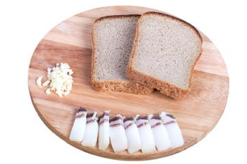 black bread, bacon, garlic on a board isolated on white backgrou