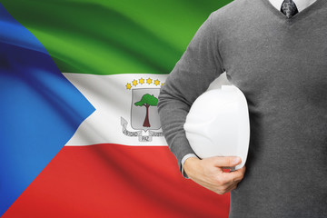 Architect with flag on background  - Equatorial Guinea