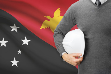 Architect with flag on background  - Papua New Guinea