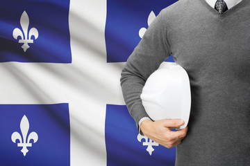Architect with Canadian province flag on background  - Quebec