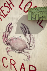 sign for fresh local crab