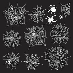 Set of 10 different spiderwebs and spiders on black background