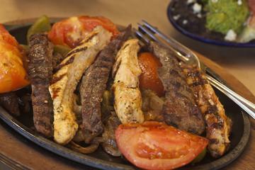 steak and chicken fajitas with gucamole