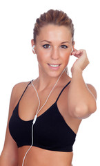 Prettywoman doing fitness listening music with headphones
