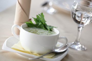 green creamy soup in restaurant