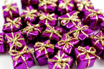 macro of colourful purple gift shaped confetti