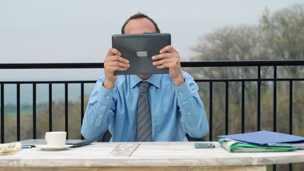 Happy businessman reading great news from stock market on his ta