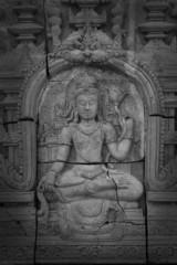 Low relief cement Thai style handcraft of hindu gods.