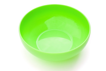 green empty plastic bowl on white with clipping path