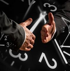 Business Handshake with Clock Overlays