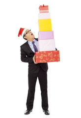 businessman holding some gift boxes. isolated on white