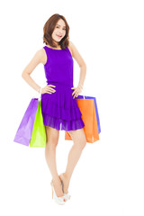 young woman walking and holding shopping bags.isolated on white
