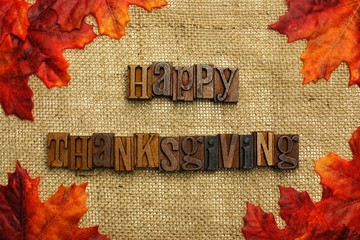 Happy Thanksgiving mesage on burlap with leaves