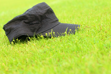 Cap lay on the the green grass.