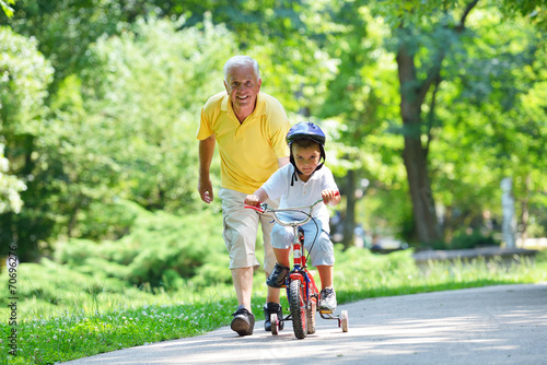 happy grandfather and child in park - 70696276