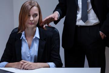 Director flirting with his secretary