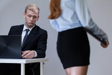 Boss looking at the secretary