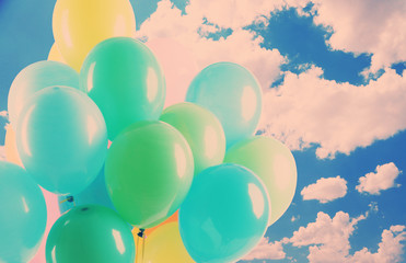 Colorful balloons on sky