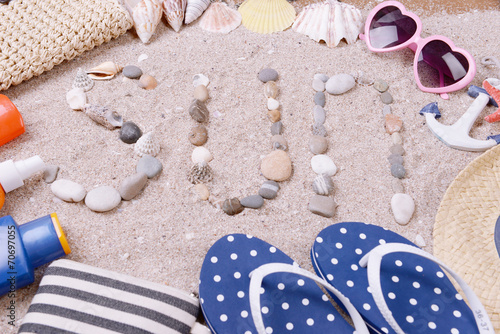 canvas print picture Word sun made from sea shells and stones
