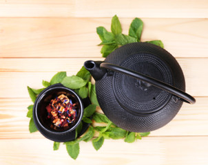 Chinese traditional teapot with fresh mint leaves and dried