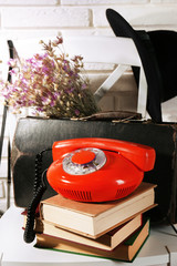 Retro composition with red phone and books
